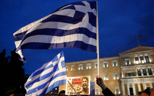 SYNTAGMA SQUARE, ATHENS, ATTICA, GREECE - 2015/02/16: captionA large Greek flag flies outside the Greek Parliament. Greeks protested a second day in a row in support of the government and against austerity policies imposed by the EU. The turnout on the day of the crucial Eurogroup meeting was considerately lower than i the previous protests. (Photo by Michael Debets/Pacific Press/LightRocket via Getty Images)