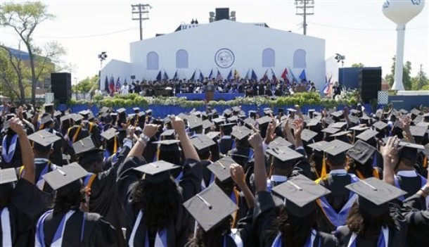 Graduates celebrate their degrees during commencement ceremonies at Hampton University in Hampton, Va., Sunday, May 9, 2010. President Barack Obama addressed the graduates at historically black university on Sunday. (AP Photo/Steve Helber)