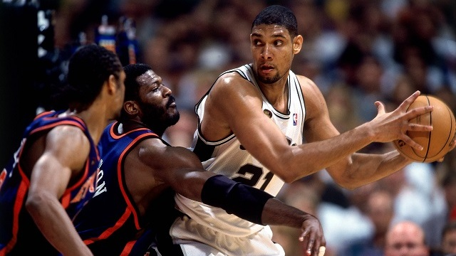 SAN ANTONIO - JUNE 18:  Tim Duncan #21 of the San Antonio Spurs shoots against Larry Johnson #2 of the New York Knicks in Game Two of the 1999 NBA Finals played at the Alamodome on June 18, 1999 in San Antonio, Texas.  NOTE TO USER: User expressly acknowledges that, by downloading and or using this photograph, User is consenting to the terms and conditions of the Getty Images License agreement. Mandatory Copyright Notice: Copyright 1999 NBAE (Photo by Andrew D. Bernstein/NBAE via Getty Images)