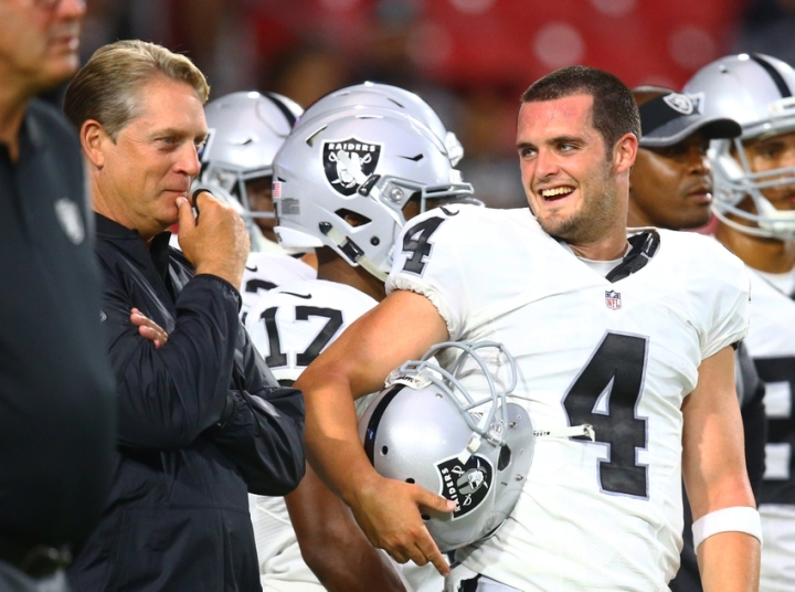 Aug 12, 2016; Glendale, AZ, USA; Oakland Raiders head coach Jack Del Rio and quarterback Derek Carr (4) against the Arizona Cardinals during a preseason game at University of Phoenix Stadium. Mandatory Credit: Mark J. Rebilas-USA TODAY Sports